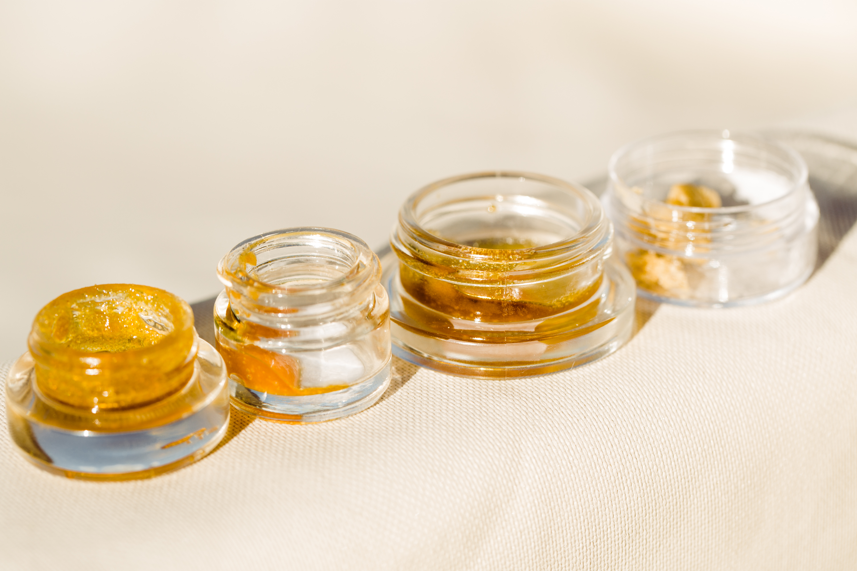 photo of Cannabis Concentrates 101: Explore Shatter, Budder and More image