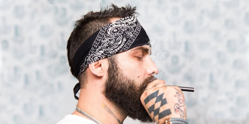 Man smoking a PAX Vaporizer(Discover the best vaporizers to try this summer)