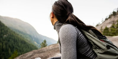 Woman hiking with Portable Vaporizer